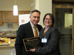 Executive Constantine presented a plaque to Imagine Housing Director Ann Levine in recognition of Veterans and Human Services Levy funding.