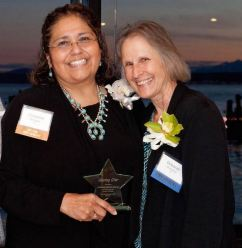 Christina Enriquez (left) receives the Shining Star award from KCNA Vice President Deborah Greenleaf.