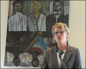 Adrienne Quinn, Director of the Department of Community and Human Services, speaking at the opening of August Wilson Place