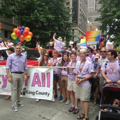 Pictured: King County Executive Dow Constantine at the 2015 Pride Parade with the King County employee group.