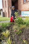 A young woman views the garden her mosque received through the RainWise program.