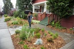 Employee Roberta King in her RainWise garden.