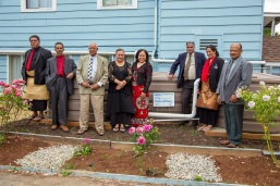 Members of a Tongan church in south Seattle are pictured with the cisterns they received by participating in RainWise.