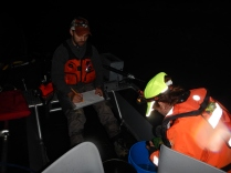 Chris and other researchers out at night monitoring the fish.