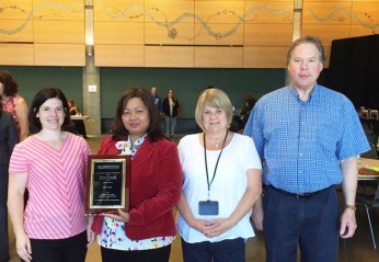 Accepting the U.S. Communities Appreciation Award for King County are (l-r) Lindsay Pryor, Sien Sok, Paula Wilz, and Mark Hoge