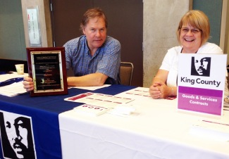 Mark Hoge and Paula Wilz at the King County table with the U.S. Communities award