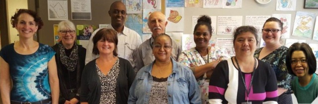 The staff at Public Health's Refugee Health clinic from L-R, back Debra Vonnahme, Franck Bamage, Hossein Eslami, Helena Wilson-Brown, JenRenee Paulson; front Wendy Dell, Annette Holland, Shary Robinson, Maggie Po, Vilay Wang