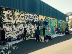 """Young artists from around the Pacific Northwest spruce up the outside of the Archives and Records Center during the """"Keeping it Fresh"""" graffiti contest"""