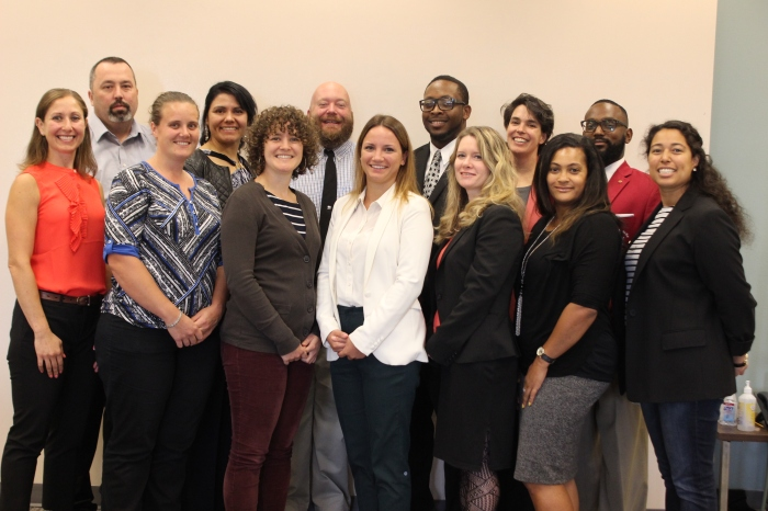 Pictured: This year's Bridge Fellowship participants ar back row from left to right: Sean Douglas (KCIT), Linda Morales (DPH), Kerwin Pyle (DNRP), Mike Rheubottom (DOT), Ann Moses (KCIT) and Anttimo Bennett (KCSC). Front row from left to right: Kate Stein (DPH), Kelsey Hatch (KCAO), Rose Hickman (DCHS), Valerie Ceban (DES), Lynn Mckiernan Ngari (DES), Kamilah Brown (KCC) and Lilia Cabello Drain (DES).