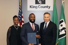 Primary Bridge facilitator Debra Baker, graduate Anttimo Bennett, KCSC, and King County Executive Dow Constantine.