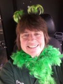 Bus operator Kathy Maddux in festive St. Patrick's Day gear.