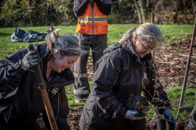 Pictured: Far right, DNRP Director Christie True participates in the planting one million trees initiative.