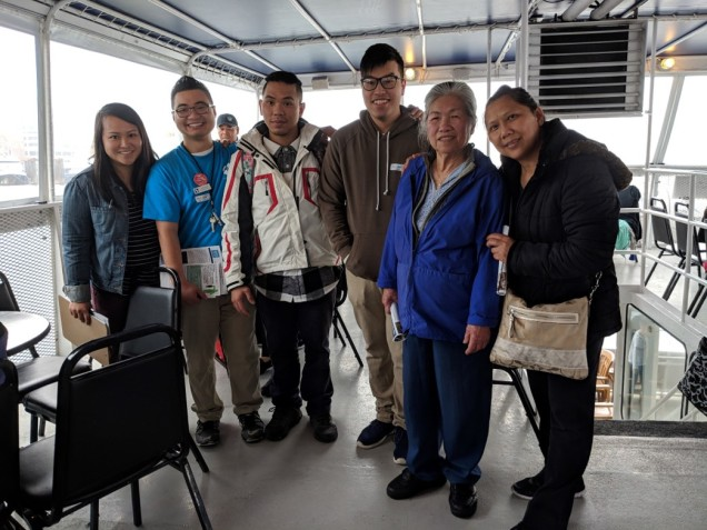 Pictured: Khanh Ho, far left, with the Vietnamese Community Health Advocates on a boat tour outreach of the Duwamish River in 2018.